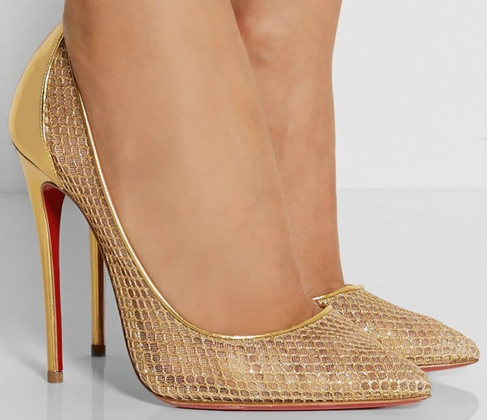 Finished with the unmistakable red sole, this pair is crafted from gold leather and glitter-finished fishnet fused onto a sheer mesh