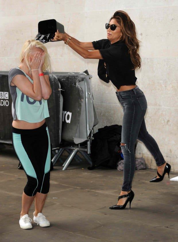 Nicole Scherzinger helps her fan Steffie Crozon with the Ice Bucket Challenge at Radio 1 in London