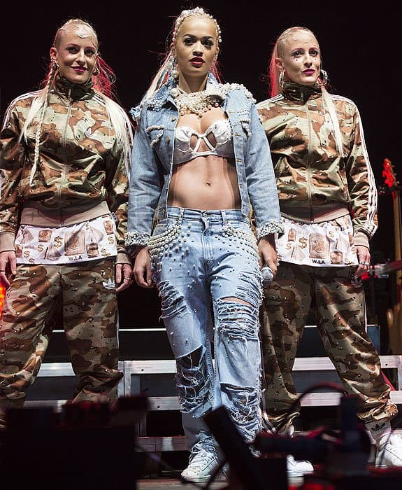 Rita Ora on stage with her backup dancers