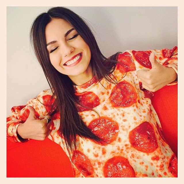 Victoria Justice wearing a pizza-print sweatshirt