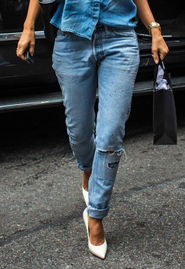Jessica Alba'sripped boyfriend jeans have a lighter tone while her button down shirt looks several shades darker