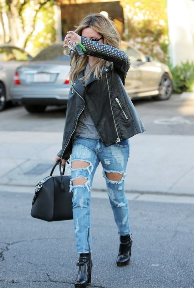 Ashley Tisdale wearing black leather jacket and ripped jeans, seen leaving Andy LeCompte Salon in West Hollywood, Los Angeles, California on October 21, 2014