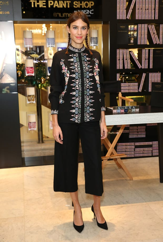 Alexa Chung wearing an embroidered wool Vilshenko 'Sofia' jacket and wide leg cropped wool pants