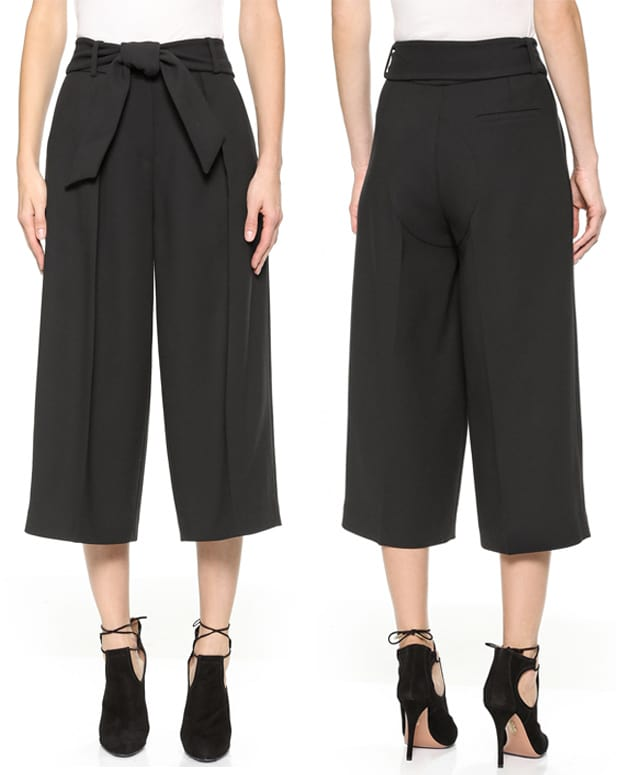 These creased ISSA trousers have modern proportions with a cropped, wide-leg profile