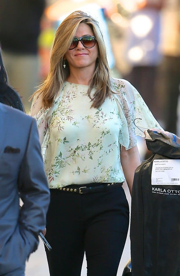 Jennifer Aniston chose a simple boxy top with chiffon sleeves and tucked it in her pants
