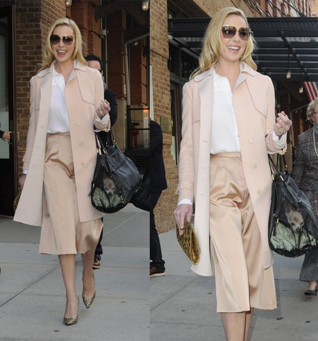 Katherine Heigl leaving her hotel in Manhattan wearing sunglasses, long peach coat, cropped pants and gold patterned shoes in New York on November 13, 2014