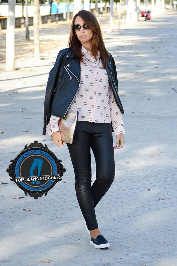 Silvia styled her leather pants with a printed button-down shirt, a moto jacket, and slip-on loafers