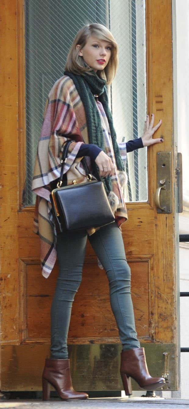 Taylor Swift layers a checkered poncho over her skinny pants