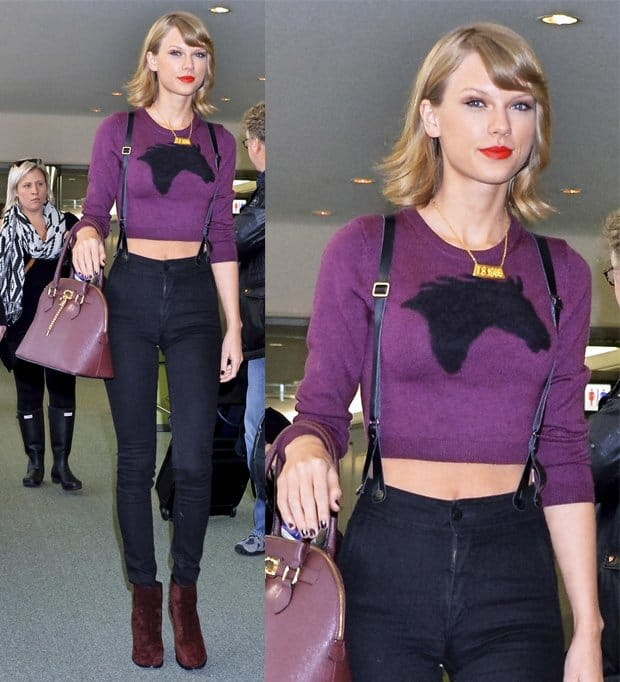 Taylor Swift leaves Narita International Airport, wearing trousers with braces, a purple cropped jumper and red ankle boots in Japan on November 8, 2014