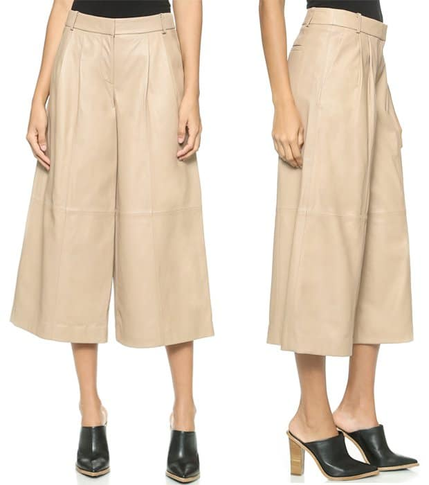 Pleating accentuates the cropped, wide-leg cut of these leather Tibi pants