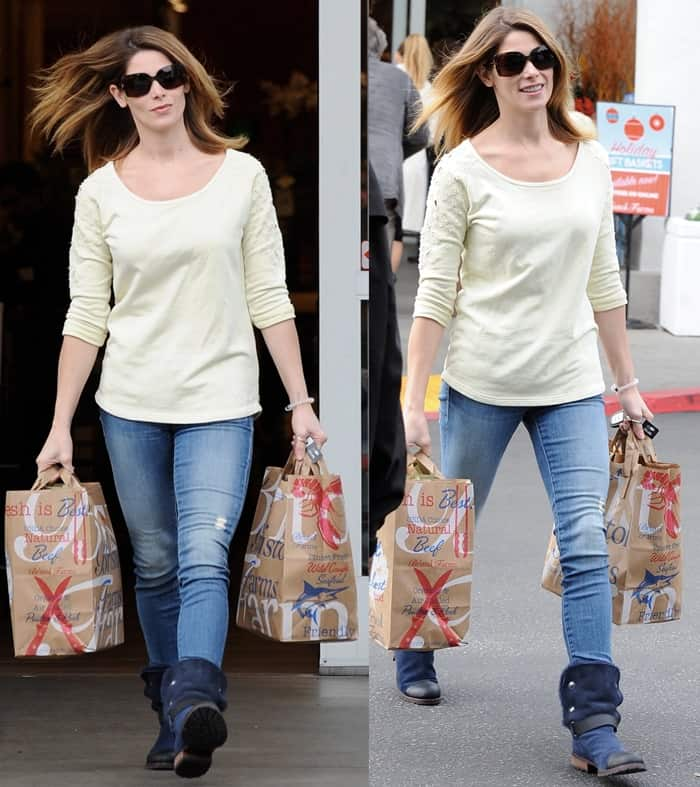 Ashley Greene styled distressed jeans with a patterned sweatshirt
