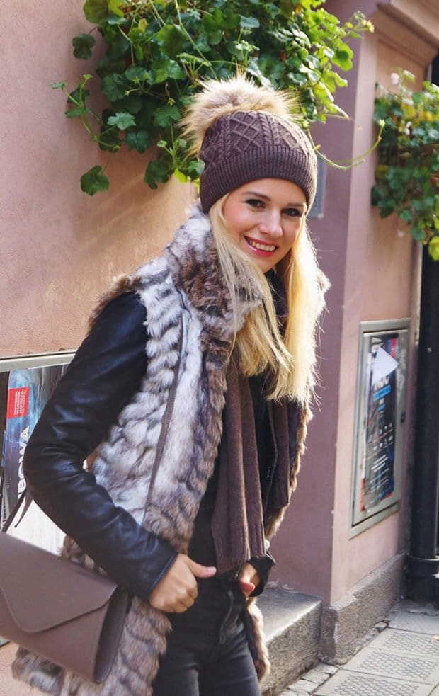 Kamila shows how to style a leather jacket with a fur vest