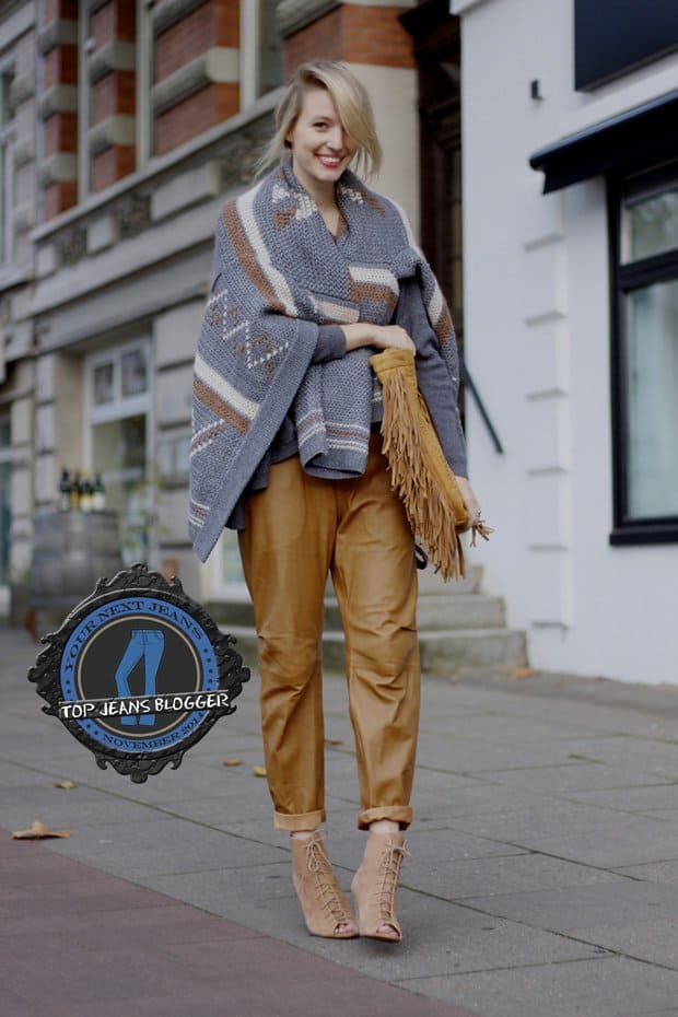 Leonie shows how to style slouchy leather pants with an equally slouchy grey sweater