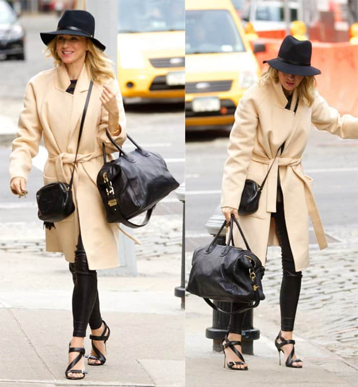 Naomi Watts out and about in New York City wearing a large black hat, beige cashmere coat, leather pants, high heel shoes and carrying two Givenchy bags in New York on October 20, 2014