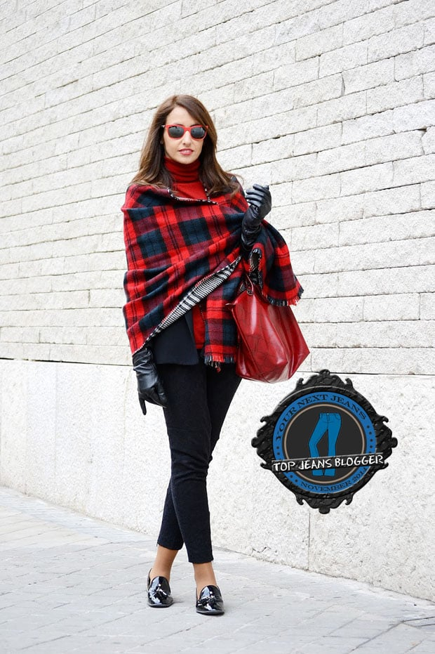 Silvia shows how to wear black pants with a colorful plaid scarf