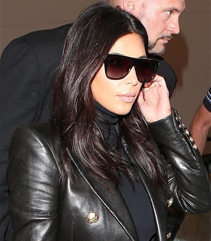 Kim Kardashian arrives at Los Angeles International Airport (LAX) on October 26, 2014