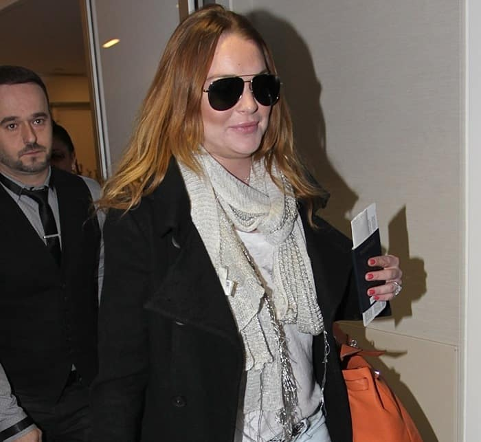 Lindsay Lohan arriving at LAX on December 30, 2014