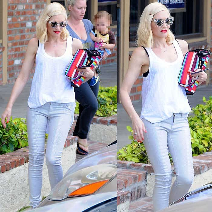 Gwen Stefani demonstrates how a simple white tank complements both skinny snake-print pants