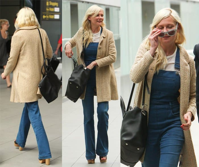 Kirsten Dunst arrives at London airport to catch a flight wearing a pair of denim dungarees in London on August 27, 2014