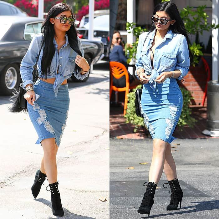 Kylie Jenner in a distressed denim skirt and an unbuttoned denim shirt