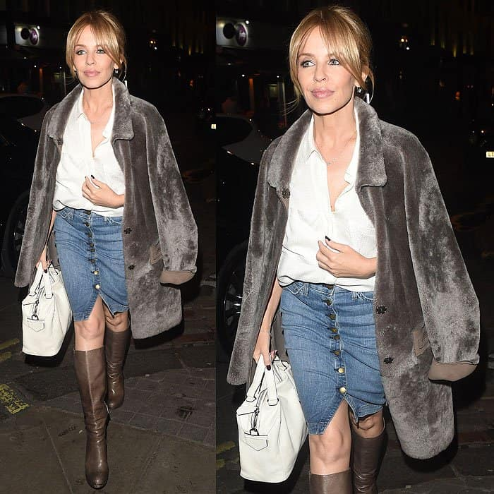 Kylie Minogue put a sophisticated spin on a button-up denim skirt by pairing it with a classic white shirt and a gray fur coat