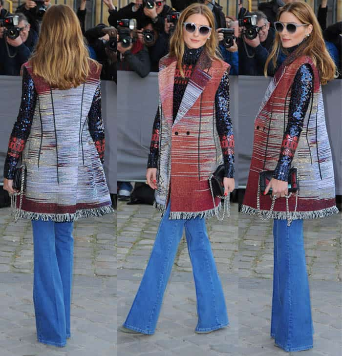 Olivia Palermo in wide-legged jeans, a vest, and a sequined sweater