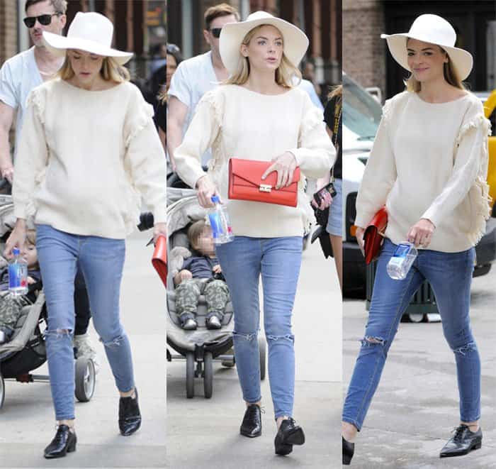 Jaime King wears ripped jeans with an oversized sweater in SoHo