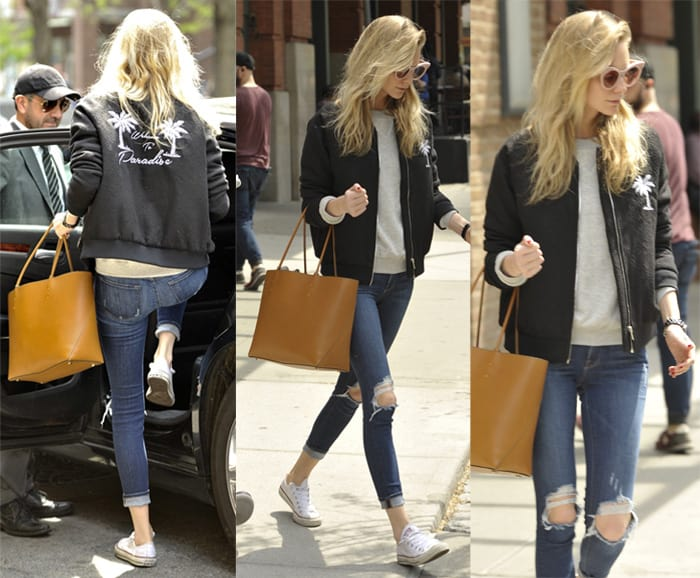 Poppy Delevingne rocks ripped jeans leaving her hotel in New York