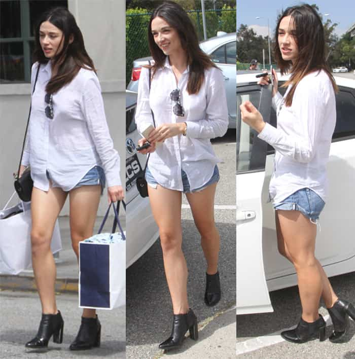 Crystal Reed paired her daisy dukes with a white button down shirt
