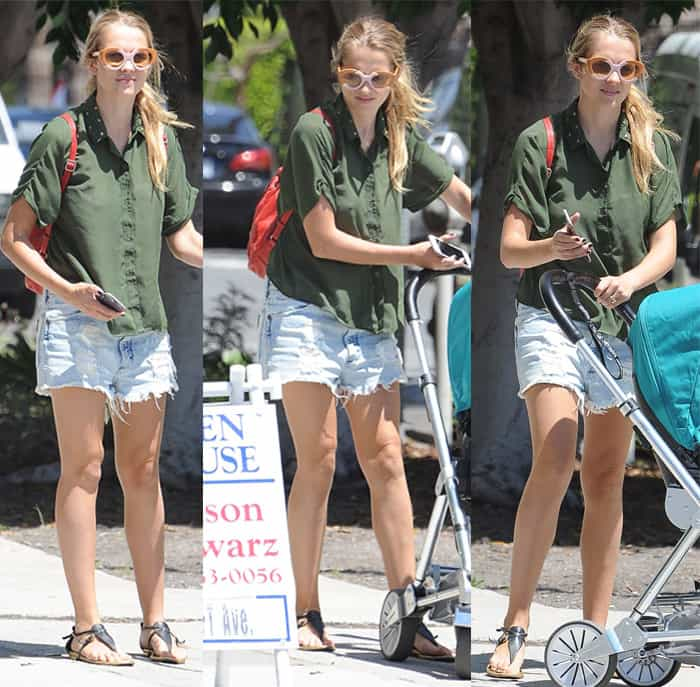 Teresa Palmer opted for a short-sleeved one and capped off the look with a pair of flat sandals and quirky sunglasses