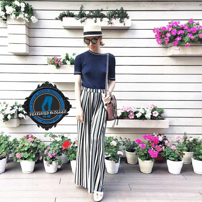 Valeriya shows how to wear striped palazzo pants with a knitted top