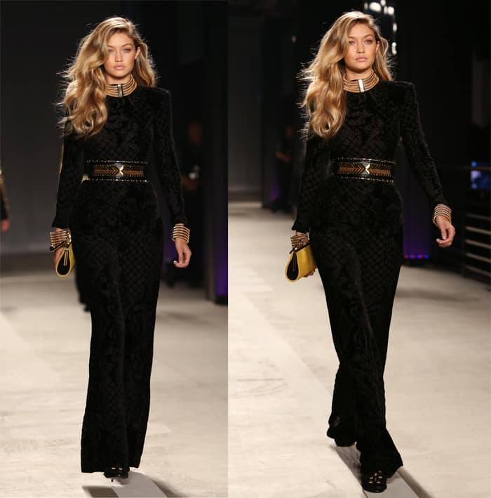 Model Gigi Hadid walks the runway wearing BALMAIN X H&M collection during the launch event at 23 Wall Street
