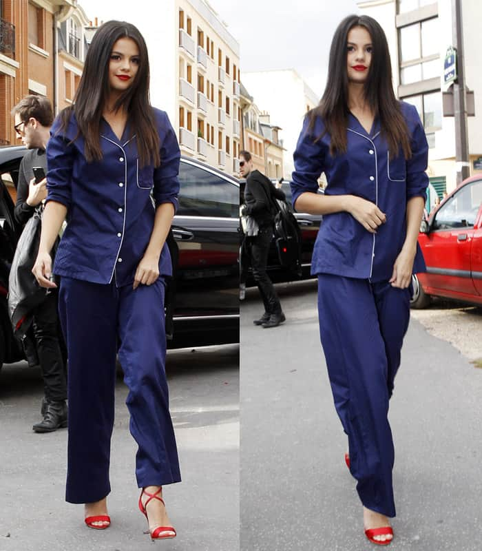 Selena Gomez wears a Derek Rose Lombard pajama set and red Brian Atwood Tamy sandals