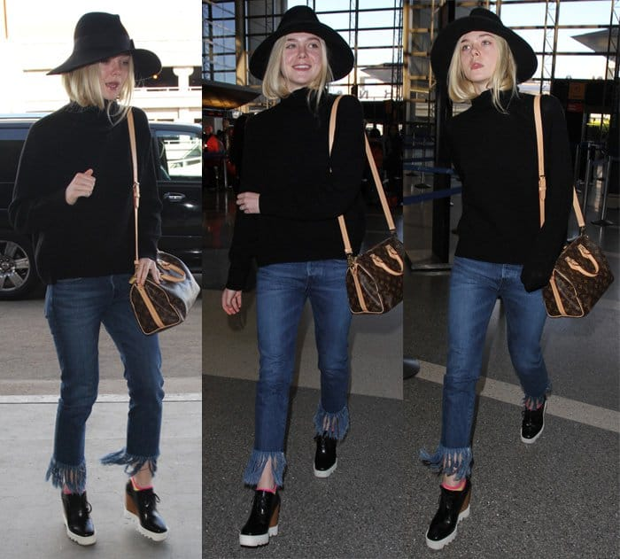 Elle Fanning wears fringe jeans with a loose sweater