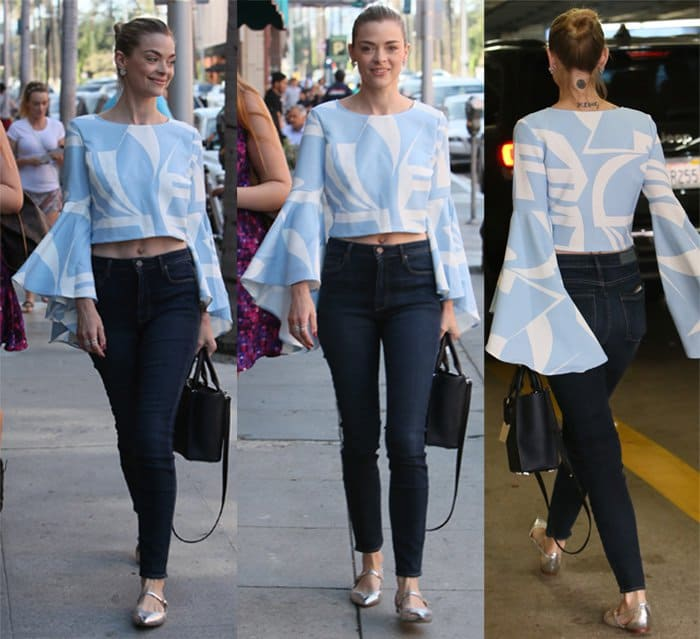 Jaime King wears a bell-sleeved top with jeans