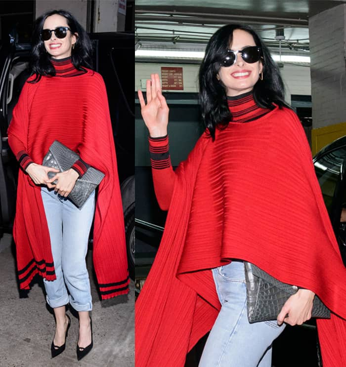 Krysten Ritter wears a red poncho while paying a visit to Huffington Post