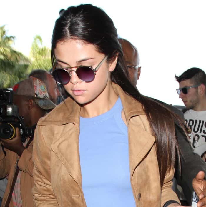"Selena Gomez rocks Simon Miller x Moscot ""001"" sunglasses at Los Angeles International Airport"