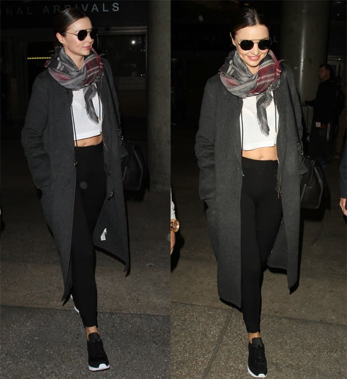 Miranda Kerr departs on a flight from Los Angeles International Airport in California on November 19, 2015