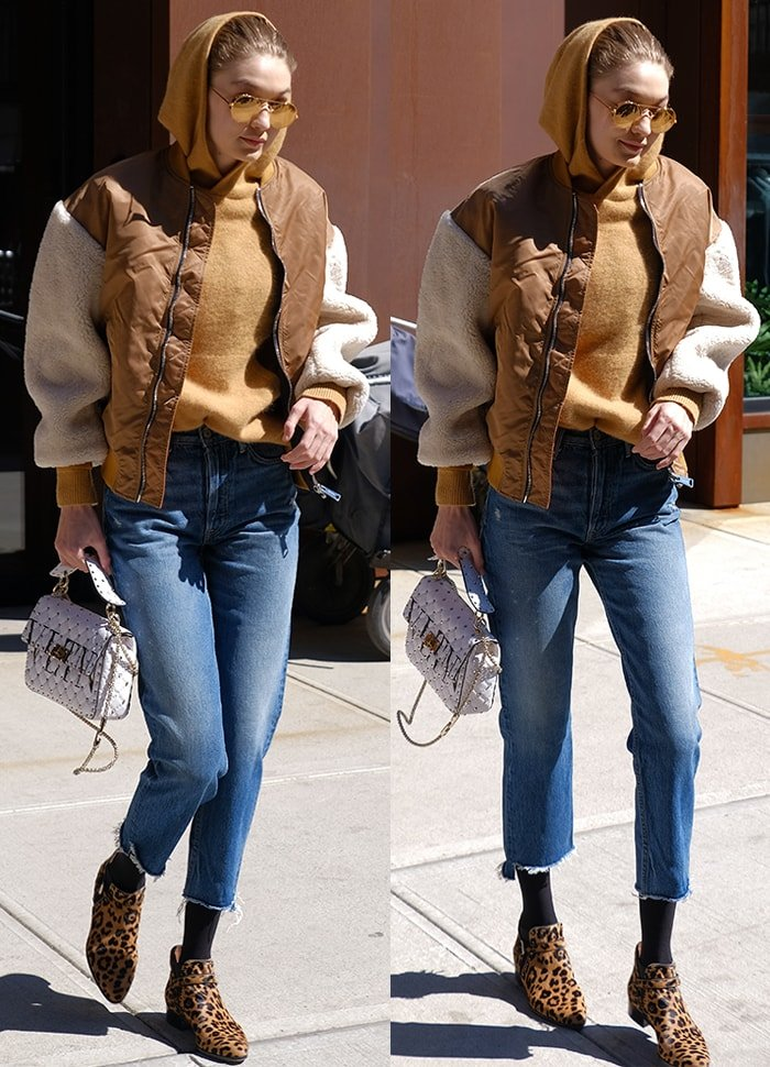 Gigi Hadid bundles up in a sweater, jacket, cropped jeans, and leopard booties