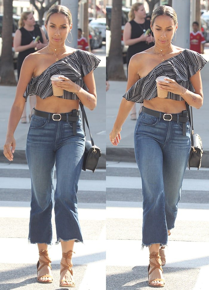 Leona Lewis looks chic in a one-shoulder crop top and flared cutoff jeans