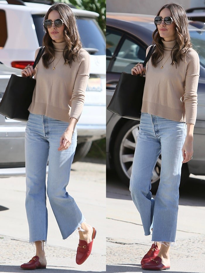 Louise Roe in cutoff jeans, beige sweater, and red mules