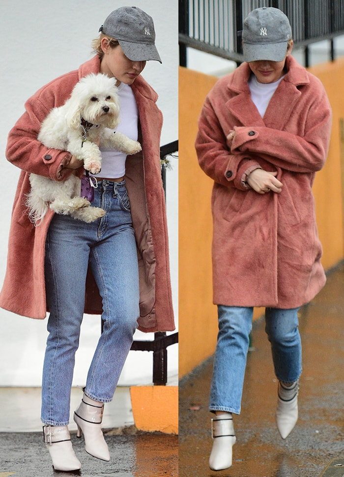 Lucy Hale wears a pair of vintage crop jeans with white tee, coat, and white boots