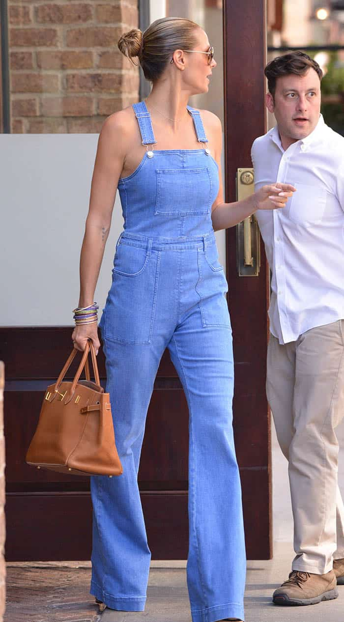 Heidi Klum leaving her hotel in denim jumper
