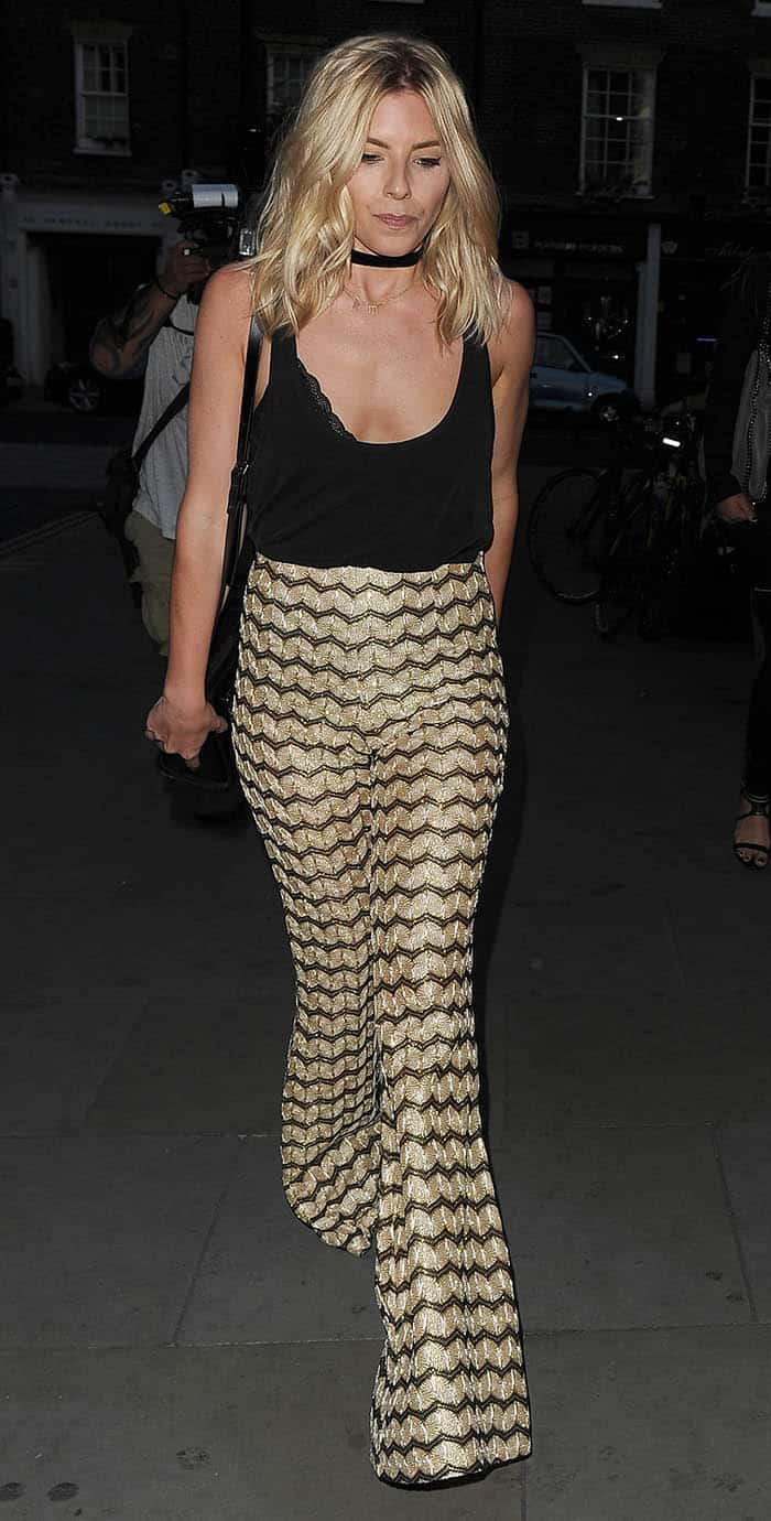 Mollie King arrives at the Chiltern Firehouse for dinner wearing gold trousers in London on August 15, 2016