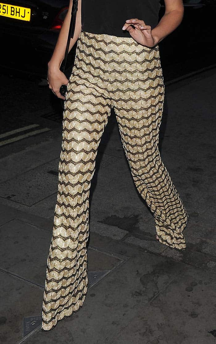 Mollie King's striking gold flare trousers