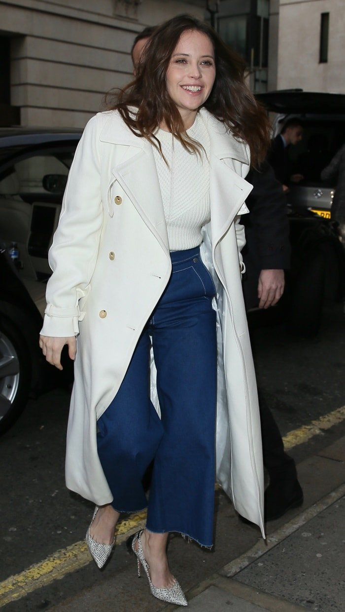 Felicity Jones arriving at Radio 2 in London wearing cut-off high-waist flare jeans on February 13, 2019