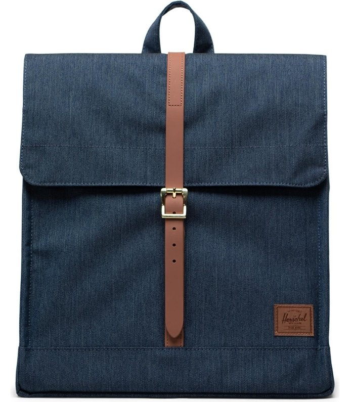 Cool knapsack style defines a vintage-inspired backpack crafted from indigo-wash denim with faux leather trim