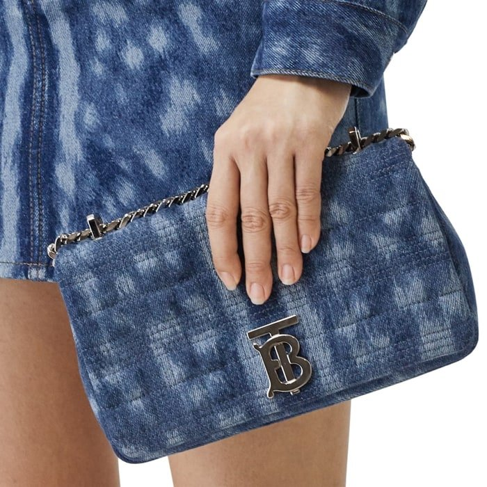Burberry's signature check motif is quilted into the denim of this scaled-down shoulder bag suspended from a chain-and-leather pull-through strap