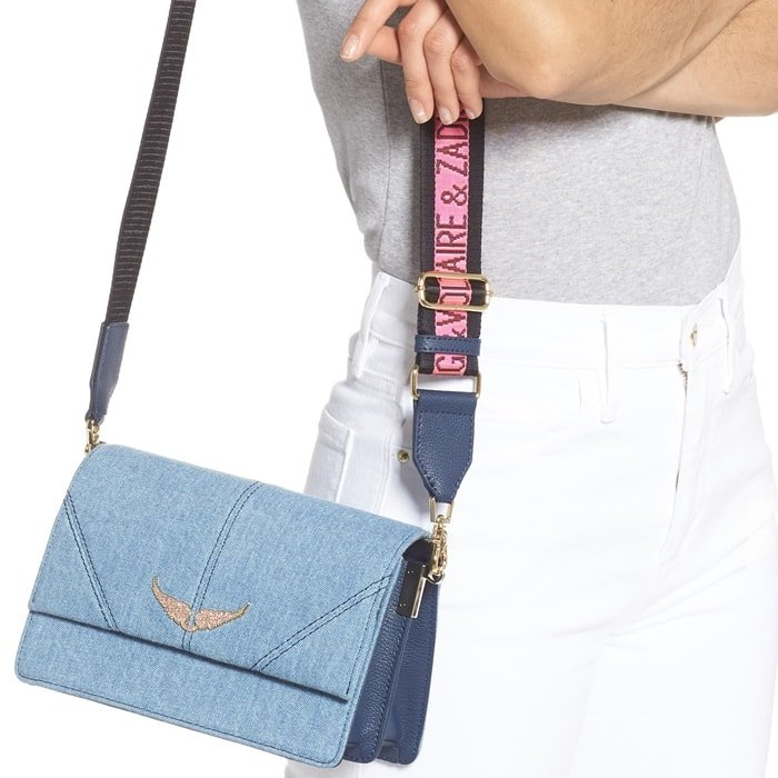 Pavé wings and a logo-embellished web strap add brand recognition to this compact structured bag made of light-wash denim