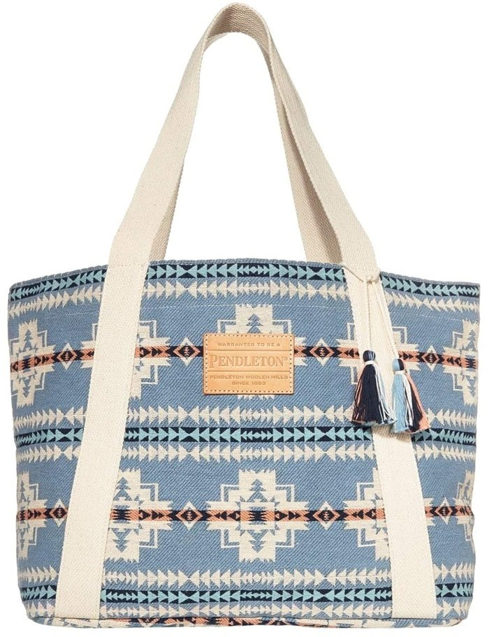 The Pendleton Cotton Tote pairs great with your denim looks with its graphic pattern throughout and tassel detailing